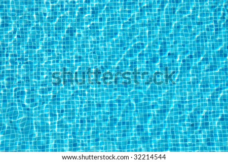 water surface of a resort swimming pool - stock photo