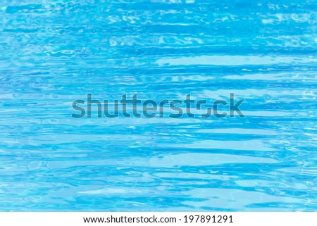 water surface ripple in swimming pool background. Defocused blur background. - stock photo