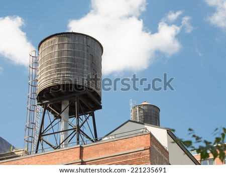 Water tank on the top of a building, New York City - stock photo