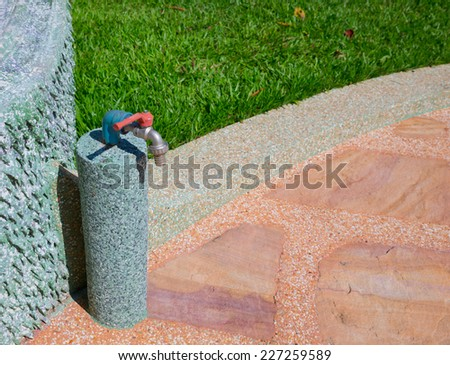 water tap in garden - stock photo
