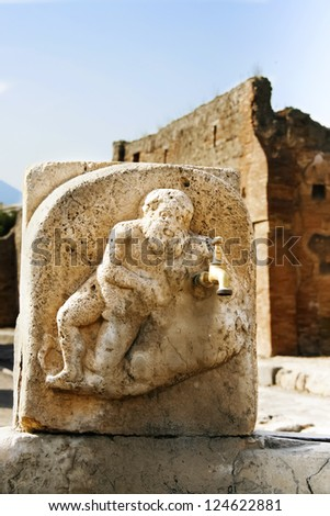 water tap in ruined pompeii - stock photo