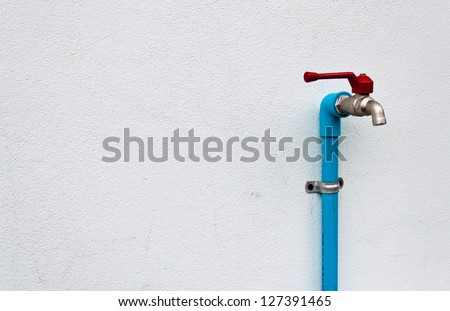 water tap on wall - stock photo