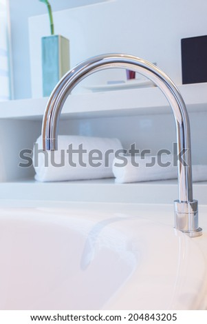 Water Tap with bathroom interior background - stock photo