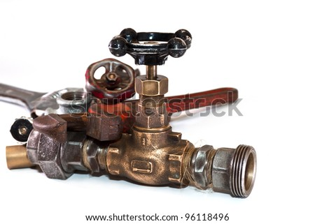 Water taps, pipe wrench on a white background - stock photo
