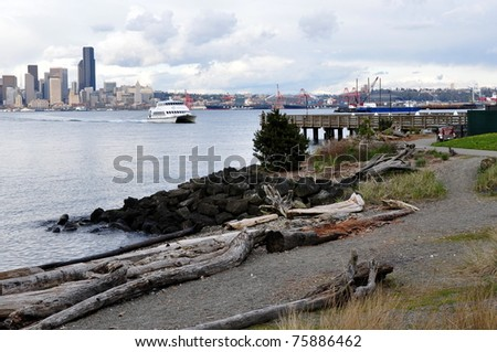 Water taxi with skyline in the background - stock photo
