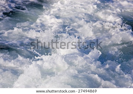 Water thrust from powerful engines in Pacific Ocean - stock photo