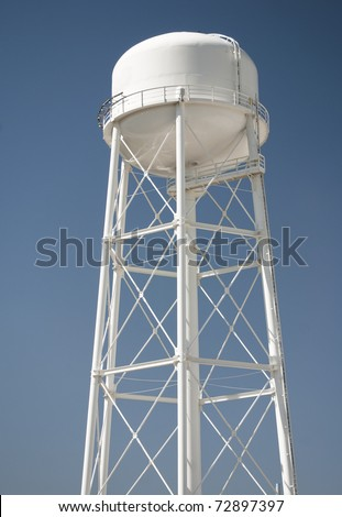 Water tower against blue sky - stock photo