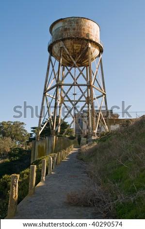 Water tower and prison building, Alcatraz Penitentiary, Alcatraz Island, San Francisco Bay, California - stock photo