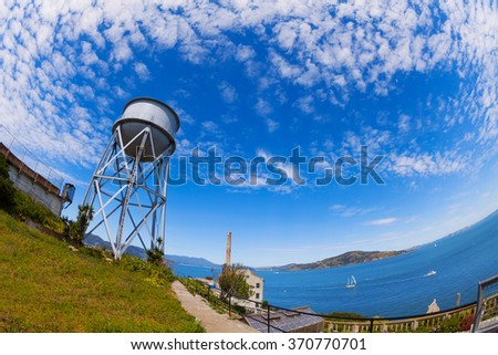 Water tower in Alcatraz island and SF bay - stock photo