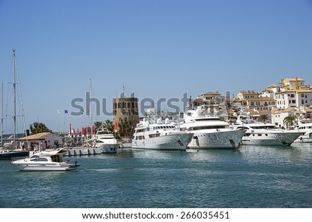 Water traffic of civil boats and luxury yachts in summer Puerto Banus - stock photo