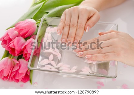 water treatment for female hands, close-up - stock photo