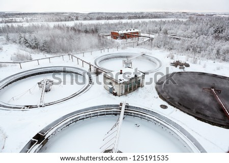 Water treatment in sewage settlers in winter season - stock photo