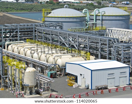 Water treatment plant and storage tanks - stock photo