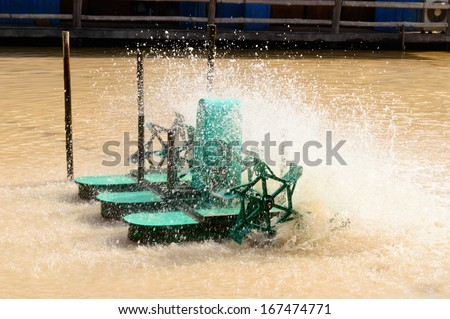 water treatment turbine engine in pool - stock photo