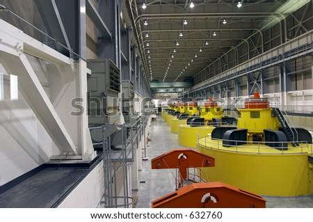Water turbines and power generators in the power plant - stock photo