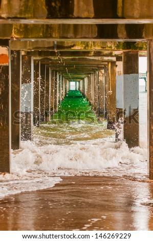 Water under a ocean pier - stock photo