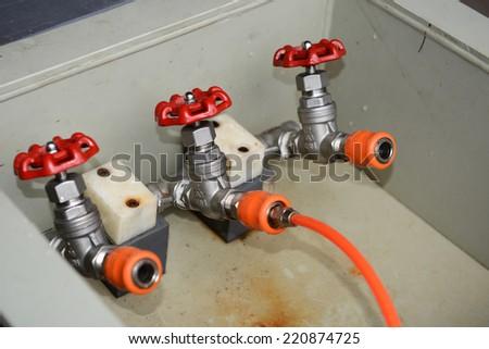 water valve pump test coiled orange hose  - stock photo