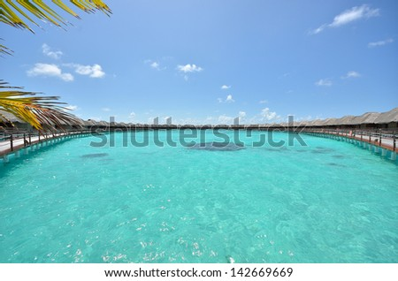 Water villa panorama -- Water villas in the lagoon - stock photo