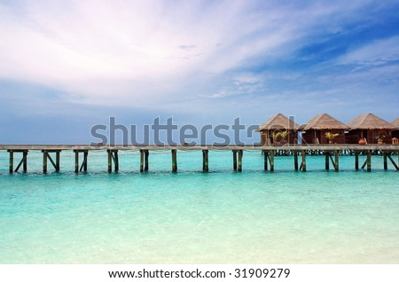 water villas and jetty on Maldives - stock photo