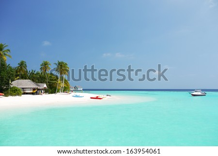 Water Villas (Bungalows) on the Perfect Tropical Island in Maldives - stock photo