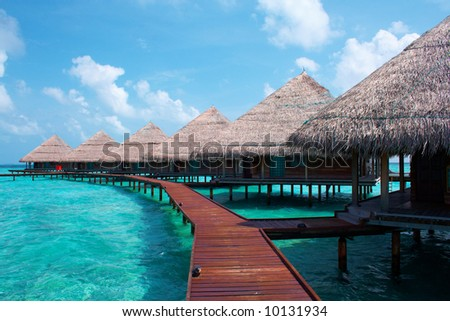 Water Villas in The Ocean. Welcome to island of Paradise! Maldives. High contrast.