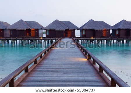 Water Villas in the sunrise. Welcome to the Paradise! Maldives. High Contrast.