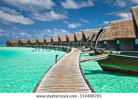 water villas on the lagoon - stock photo