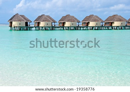 water villas on the maldives - stock photo