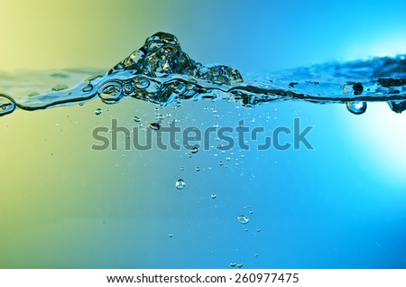 water wave  background with air bubbles - stock photo