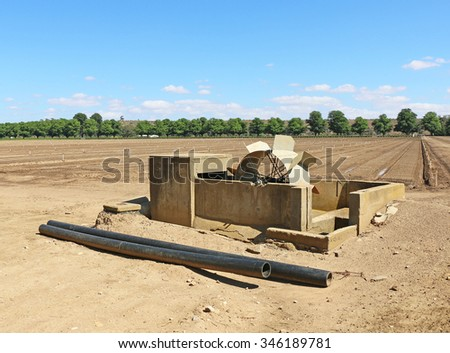 water wheel driven pump irrigation system - stock photo