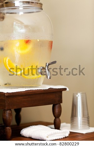 water with fruits and berries in the water dispenser in spa - stock photo