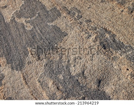 Water worn Stone Rock Close-up with line and cut with black and brown color pattern. - stock photo