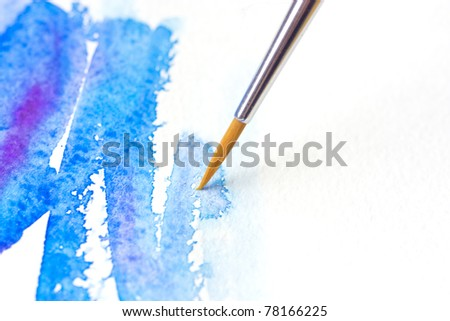 Watercolor brush with blue paint