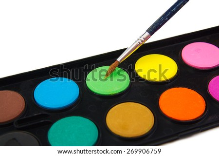 Watercolor green paint and brush on white background - stock photo