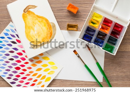 Watercolor paint box and brushes for painting - stock photo