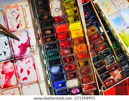 Watercolor paint box with palette and brushes - stock photo