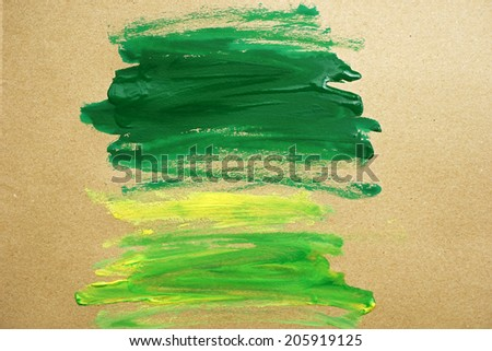 watercolor paint green strokes brush stroke color texture with space for your own text - stock photo