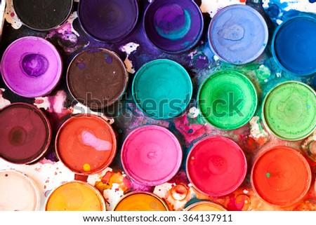 Watercolor paint palette, bright, colorful paint splatters - stock photo