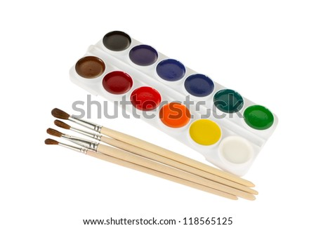 Watercolor paints and paintbrushes on a white background - stock photo