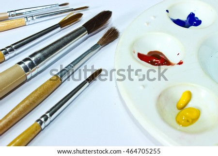 Watercolor Palette and Paintbrush Isolated on the White Background