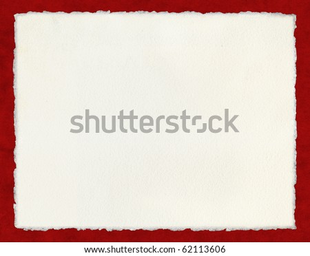 Watercolor paper with true deckled edges on a red background.  File includes a clipping path. - stock photo
