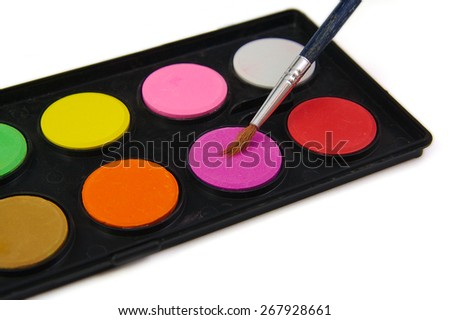 Watercolor pink color paint and brush on white background - stock photo