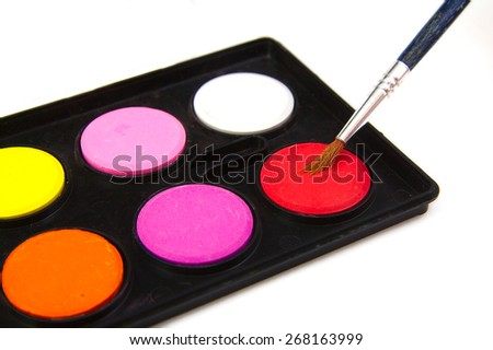 Watercolor red paint and brush on white background - stock photo