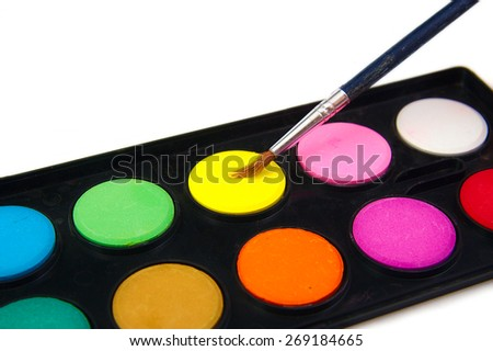 Watercolor yellow paint and brush on white background - stock photo