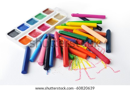 Watercolors and heap of colourfull crayons on white background
