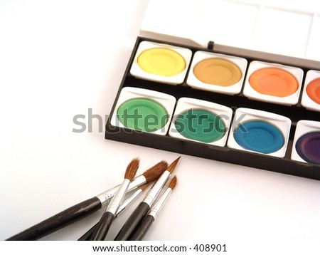 watercolors in box and painting brushes - stock photo