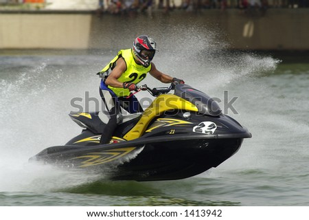 watercraft during a race by the river Guadalquivir