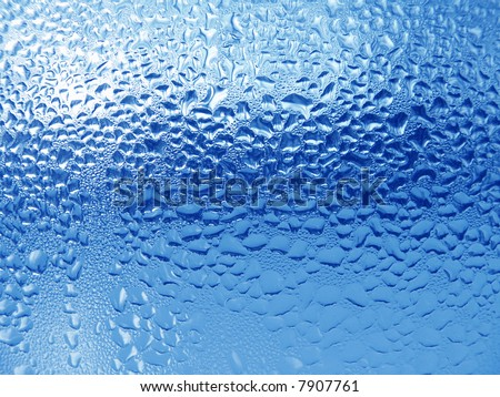 Waterdrop Close-up clear drops of water on window glass surface - stock photo