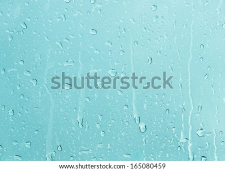 Waterdrops on a glass surface. - stock photo