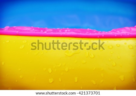 Waterdrops on swimming pool background, abstract - stock photo